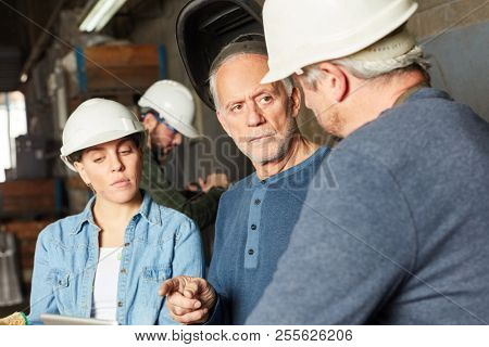Factory workers in a meeting planning in teamwork