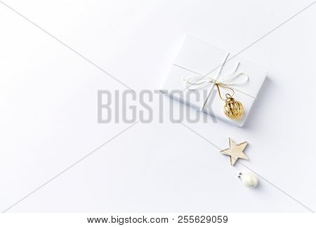 Christmas present with Christmas decorations on white background. Flatlay.  Symbolic image. Copy space