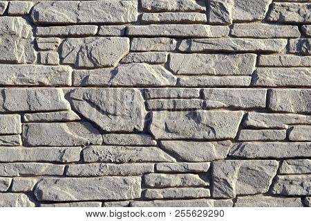 Textured Stone Walls Built Of Large Rough Stones Held Together By  Lumps Of  Cement . Stones Backgro