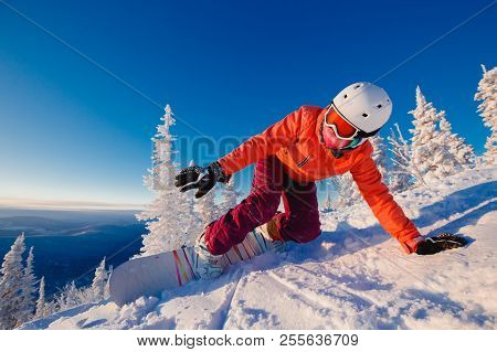 Snowboarder On Snowboard Rides Through Snow, Explosion. Freeride Snowboarding In Sheregesh Ski Resor