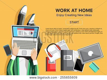 Work At Home Business Concept. Top View Man With Phone, Headphones, Laptop And Business Reports. Sel