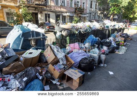 Odessa, Ukraine - A Pile Of Garbage With Garbage Bags Full Of Garbage Cans On The City Street. Many