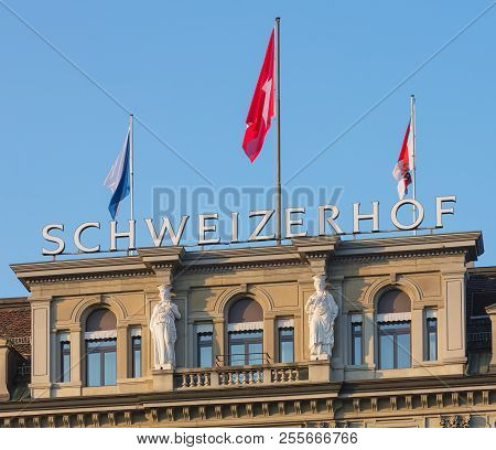 Zurich, Switzerland - August 26, 2018: Upper Part Of The Hotel Schweizerhof Building Decorated With