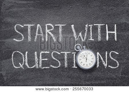 Start With Questions Phrase Written On Chalkboard With Vintage Stopwatch Used Instead Of O