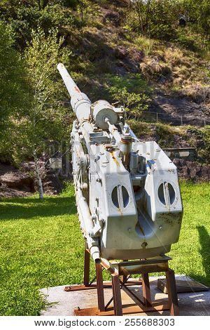 World War I Cannon Under A Mountain, Vertical Image