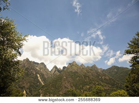 Mountain Tops With Clouds