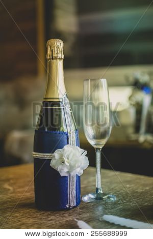 Wedding Bottle With Ribbon, Crystal Glass On A Table With Candle