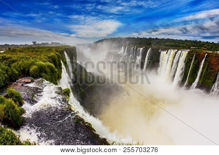 The full-flowing waterfall in the world on the Parana River. The Devil's throat /Garganta del Diablo/. Concept of extreme and active tourism