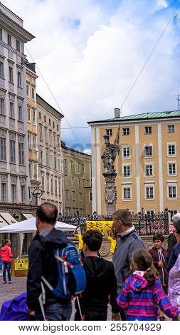 Salzburg, Austria - July 15, 2017: A Group Of Tourists In The City Center Near Falun Dafa Members De