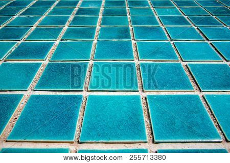Close Up Of Blue Swimming Pool Tiled Floor. Architect And Construction Concept. Material And Design