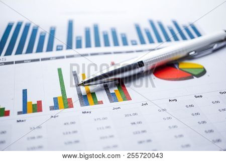 Pen On Charts Graphs Spreadsheet Paper. Financial Development, Banking Account, Statistics, Investme