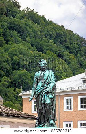 The Statue Of Mozart In The Mozart Square In Salzburg, Austria . Sculptor Ludwig Von Schwanthaler, 1