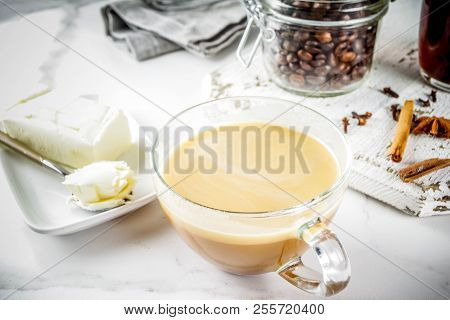 Trendy ketogenic diet food, Bulletproof coffee with milk and butter, white marble background copy space poster