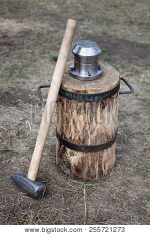 Blacksmith Hammer And Coinage Tool Standing On Ground