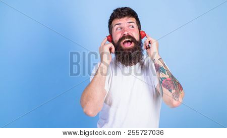 Summer Top Radio Chart. Man Bearded Hipster Red Ripe Strawberry Ears As Headphones. Guy Enjoy Juicy