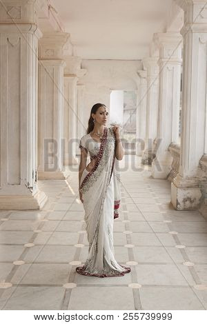 Beautiful Young Indian Woman In Traditional Clothing With Bridal Makeup And Oriental Jewelry. Girl D