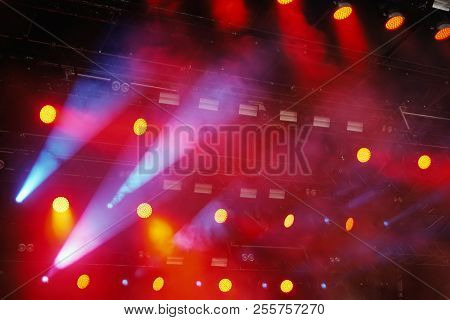 Several Red Stage Lights In The Dark