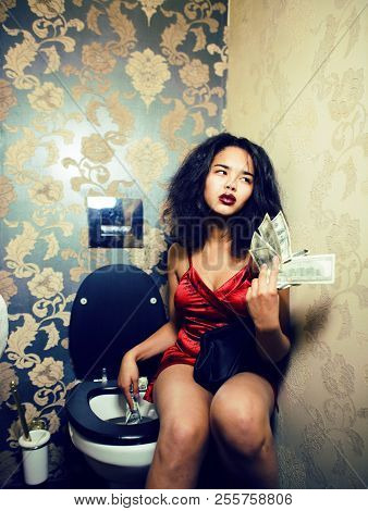 Pretty Young African American Woman In Luxury Restroom With Mone