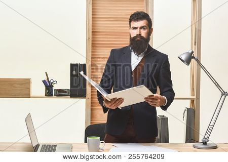Businessman In Suit Holding Folder. Business, People And Corporate Concept - Serious Business Man Wi