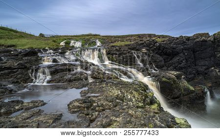 Dunseverick Falls  In County Antrim In Northern Ireland
