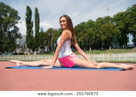 Girl Stretching Legs After Workout. Split Is Easy For Her. Stretching Muscles Every Time Training. C