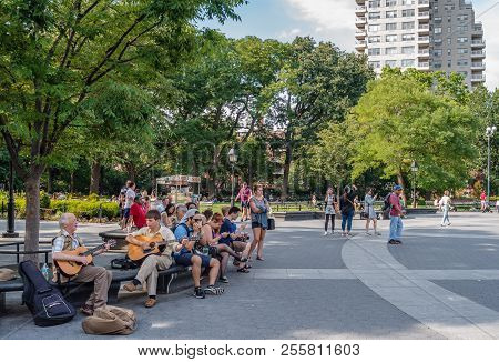 New York, Ny, Usa - July 17, 2014: An Old Man Teaches Some Guitar Licks To A Young Guitar Player, Wh