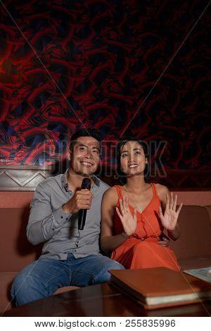 Happy Vietnamese Couple Spending Evening In Karaoke