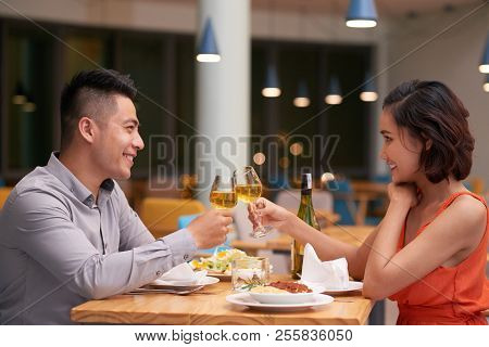 Young Vietnamese Couple Celebrating Anniversary In Restaurant