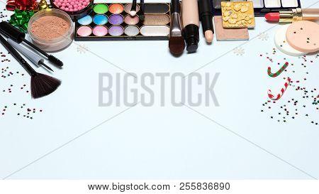 Christmas Party Makeup Background. Foundation, Powder, Blusher, Color Glitter Eyeshadow, Mascara, Ey