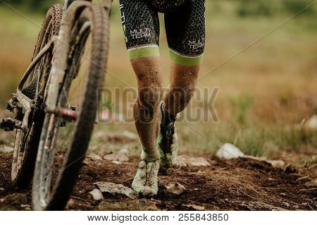 V.ufaley, Russia - August 12, 2018: Dirty Bike And Legs Mountain Biker Uphill Walk During Race Xcm B