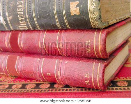 old books stack..selective doff with the main focus on the base of the books(right part of the image) poster