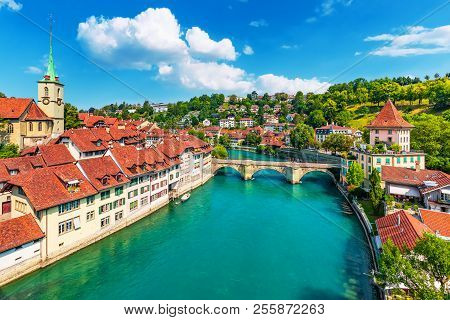 poster of Scenic summer view of the Old Town architecture of Bern with the bridge Untertorbryukke over Aare river, Berne, Switzerland
