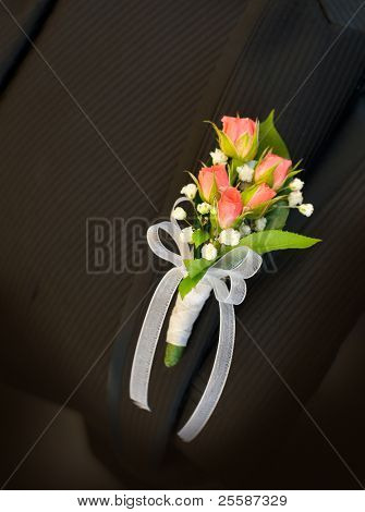 Pink roses Wedding Boutonniere On Suit of Groom