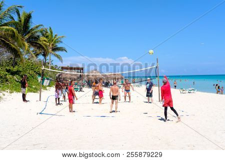 VARADERO,CUBA - AUGUST 23,2018 : Tourists playing volleyball at the beautiful beach of Varadero in Cuba