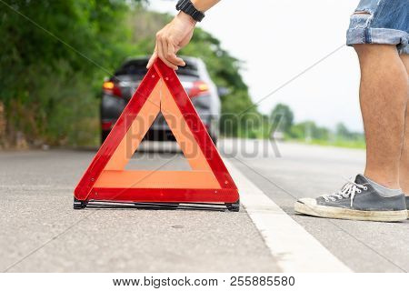A Car Breakdown Alongside The Road, Man Sets The Warning Triangle..driver Putting Out A Traffic Warn