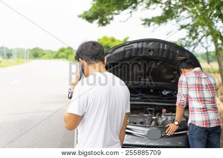 Friends Call And Fixing Car Broken Down By The Roadside. Couple Young Man Calling For Assistance Bre