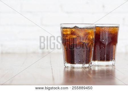Cool Iced Soft Drink Cola Carbonated Liquid Fresh Food With Soda Water In Clear Glass On Table White