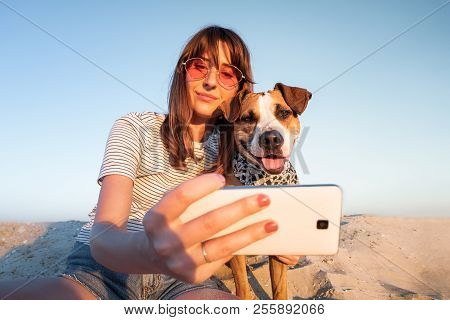 Best Friends Concept: Human Taking A Selfie With Dog. Young Female Makes Self Portrait With Her Pupp