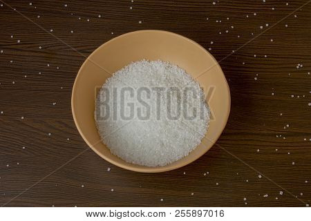 Crystals Of Sugar In The Bowl On Table