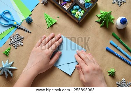 Making Origami 3D Xmas Tree With Paper For Decoration Or Greeting Card. Merry Christmas And Happy Ne
