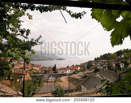 Coast of Lake Ohrid seen from Ochrid City. Ohrid is the oldest lake in Europe, known of its, clean, transparent water. Ohrid and Lake Ohrid are UNESCO natural and cultural heritage sites. Typical Macedonian architecture. Amphitheater and old town. Trave poster