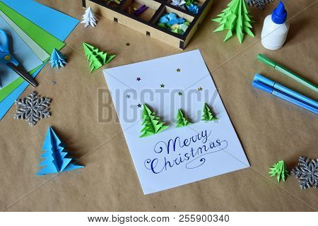 Making Greeting Card With Origami 3D Xmas Tree From Paper. Merry Christmas And Happy New Year Decora