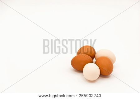 Still Life With White And Brown Eggs On A Bright White Background.