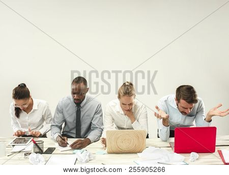 Young African And Caucasian Men And Women Sitting At Office And Working On Laptops. The Business, Em