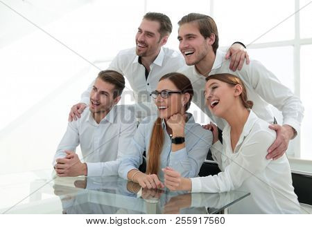 business team sitting at the table and looking forward