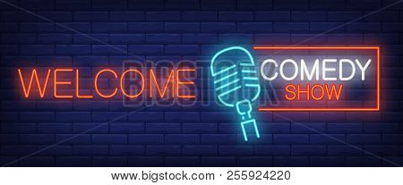 Welcome Neon Sign. Glowing Comedy Show Lettering And Microphone On Brick Background. Night Bright Ad