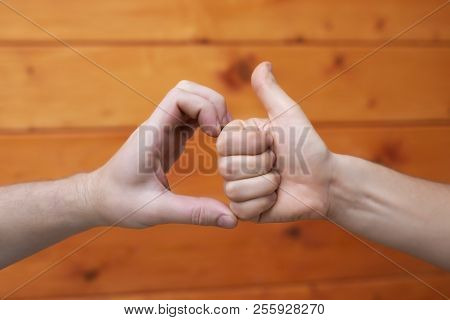 Friend Zone Symbol. Two Caucasian Hands On Wooden Background