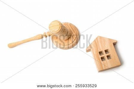A Judge Hammer And A House On A White Background. Concept Settlement Of Litigation. Buying And Selli