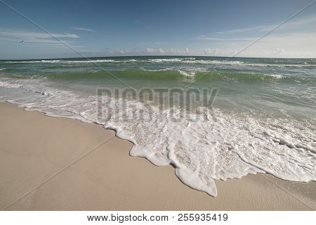 Extreme Wide-angle Scenic At Pensacola Beach In Florida. Seagulls, Breakers, Blue Skies, Emerald Wat