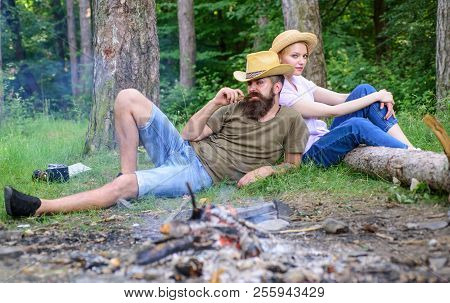 Family Activity For Summer Vacation In Forest And Nature. Family Relaxing Near Bonfire After Day Of